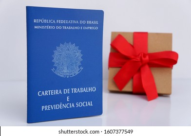 Bahia, Brazil. January 5, 2020. Brazilian work card (carteira de trabalho) and gift box. TRANSLATION: Federative Republic of Brazil, Ministry of Labor. Work record booklet and Social Welfare.