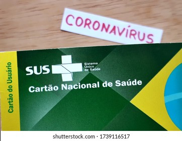 Bahia, Brazil - May 22, 2020. Translation: Brazilian Unified National Health System (SUS - Sistema Único de Saúde). / SUS card (cartão SUS)  with Coronavirus inscription in the background.