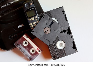 Bahia, Brazil - October 8, 2020. Old Nokia mobile phone, VHS video tape, Mega Drive console, floppy disc (diskette) and audio cassette tape. Old Technology concept. Vintage objects.