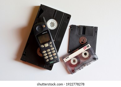 Bahia, Brazil - October 8, 2020. Old Nokia mobile phone, VHS video tape, floppy disc (diskette) and audio cassette tape. Old Technology concept. Vintage objects.