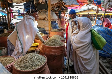 BAHIR DAR, AMHARA REGION, ETHIOPIA - JANUARY 20: Unidentified woman selling coffee beans at the market on January 20, 2018 in Bahir Dar, Ethiopia.