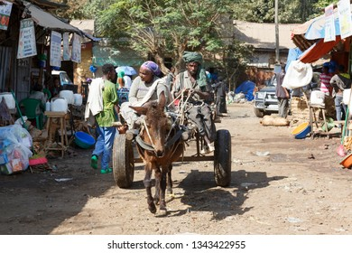 Bahir Dar, Ethiopia, February 14 2015: An old couple drives their donkey carriage through a market