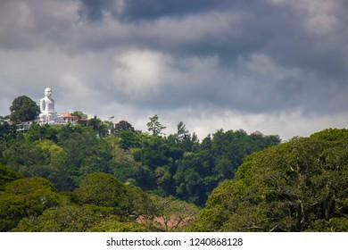 Bahirawa Kanda or Bahirawakanda Vihara Buddha Statue in Kandy, Sri Lanka at Evening. Bahirawakanda is a giant samadhi buddha statue on the top of the mountain in Kandy.