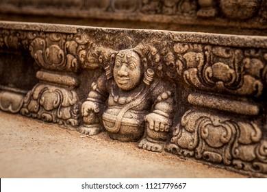 Bahirawa stone carving in intricate detail at sacred site in Anuradhapura, Sri Lanka