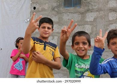 BAHKARA REFUGEE CAMP, ERBIL, KURDISTAN, IRAQ - 2015 JULY 16 - Playful children inside Bahkara (bahkara] refugee camp