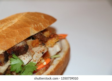 Bahn Mi is a Vietnamese cuisine. A sandwich consisting of a baguette filled with meat, pork, coriander leaf, cucumber, pickled carrots, cabbage, and deacon