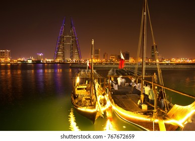 """BAHRAIN BAY, BAHRAIN - NOVEMBER 03: People visits at the coast of Bahrain bay to see & ride on traditional fishing boat """"Dhow"""" on November 03, 2017 on the occasion of cultural  sea festival at Bahrain"""