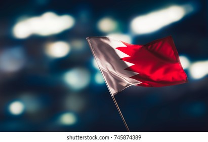 Bahrain flag waving with pride on a blurry background / high contrast image