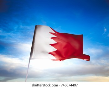 Bahrain flag waving with pride on a cloudy background / high contrast image