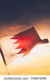 Bahrain flag waving with pride at sunset / high contrast image