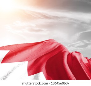 Bahrain national flag cloth fabric waving on beautiful sky background.