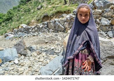 Bahrain, Pakistan - June 1 2014: A young girl wearing traditional Kohistani dress