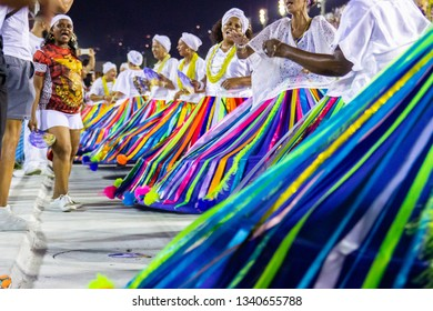 Baianas of the samba school União da Ilha, Marques de Sapucai, Rio de Janeiro, Brazil - January 23, 2019: baianas of the samba school União da Ilha during the technical rehearsal at the sambodrome.