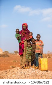 Baidoa / Somalia - March 2017 - The family who took their water distribution and poses camera with daily water.