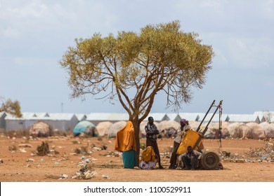 Baidoa / Somalia - March 2017 - People who carry water rest under a tree in the refugee camp.