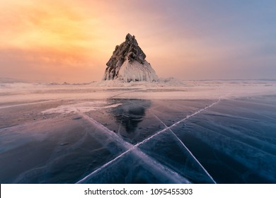 Baikal freeze water lake with rock mountain and after sunset sky background, Russia natural landscape background