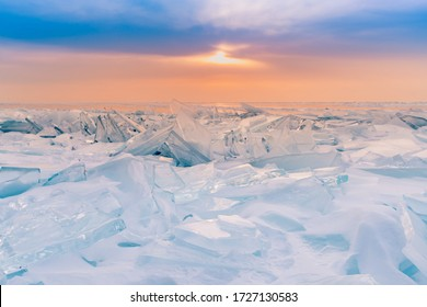 Baikal frost water lake with sunset skyline, winter season natural landscape Russia