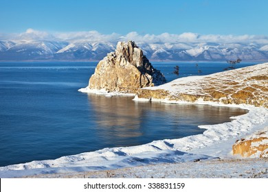 Baikal Lake in December. Shamanka Rock and Beach Bay in the snow