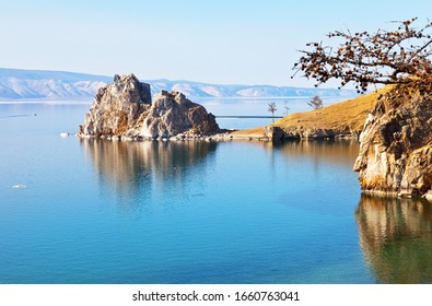 Baikal Lake on a spring day. A view of the natural landmark - Shamanka Rock from the coast of Olkhon Island near Khuzhir village. Beautiful landscape. Natural background