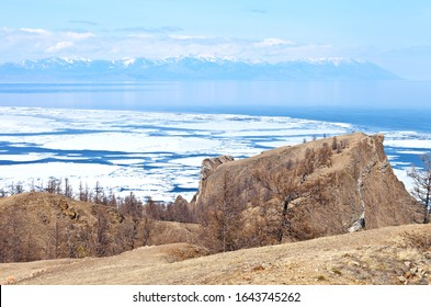 Baikal Lake in the springtime during the ice drift. View of the famous Cape Hoboy - natural landmark on Olkhon Island. Beautiful landscape. Natural spring background