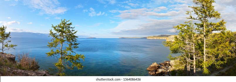 Baikal Lake in summer. Panoramic view from the shore of the Olkhon Island to the Small Sea Strait (Maloe More). Beautiful summer landscape