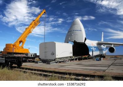 BAIKONUR, KAZAKHSTAN - AUGUST 28, 2019. Russian Volga-Dnepr Antonov AN-124 long-range heavy transport plane is being unloaded in Yubileiny airport.