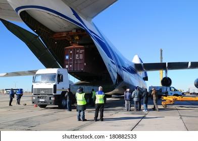 BAIKONUR, KAZAKHSTAN - NOVEMBER 11, 2013. Russian Volga-Dnepr Antonov AN-124 long-range heavy transport plane is being unloaded in Yubileiny airport.