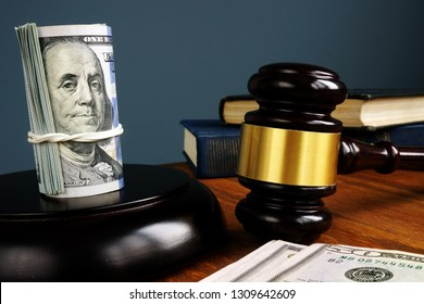 Bail bonds and fine concept. Money and gavel as symbol of law.