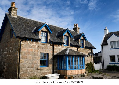 Baile Mor, Isle of Iona, Scotland, UK - June 10, 2018: Stone house with blue trim on main street of Baile Mor village on Isle of Iona Inner Hebrides Scotland UK