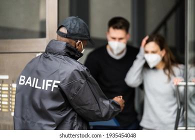 Bailiff Debt Collector At Door In Mask