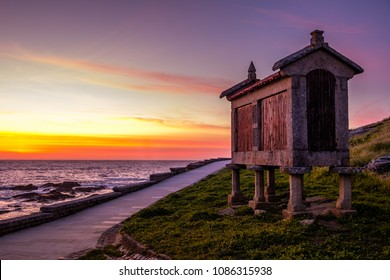 Baiona, Espanha - May 03, 2018 : At the foot of the sea this beautiful granary is illuminated by the last rays of sun , Pontevedra, Espanha