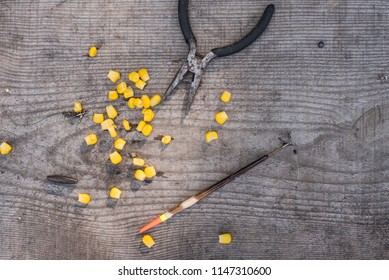 Bait for fish on a wooden background.