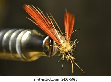 Bait fishing on mountain river. Imitation flies or moths