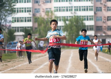 Baixiang County, Hebei Province, China - May 10, 2013. Baixiang County Middle School Track Meet held in May 10, 2013. Student athletes worked hard toward the finish line.