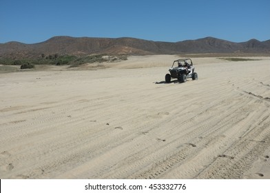 BAJA CALIFORNIA SUR, MEXICO - FEBRUARY 28, 2016: Dune buggy at beach on Pacific Ocean north of Cabo San Lucas, Baja California Sur, Mexico