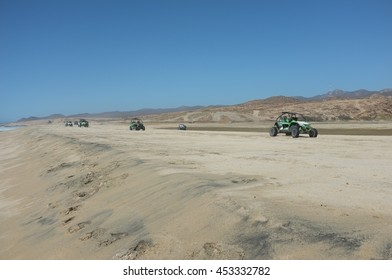 BAJA CALIFORNIA SUR, MEXICO - FEBRUARY 28, 2016: Dune buggies at beach on Pacific Ocean north of Cabo San Lucas, Baja California Sur, Mexico