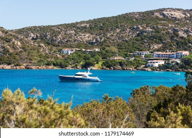 BAJA SARDINIA, ITALY - SEPTEMBER 21, 2017: A view of the quiet cove Spiaggia Porto Piccolo in Baja Sardinia, in the famous Costa Smeralda, in Sardinia, Italy