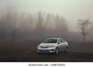 BAJNA, HUNGARY - OCTOBER 28, 2016: Toyota Corolla 2011 model E15 facelift in a foggy landscape. Corollas are one of the best selling cars in the world