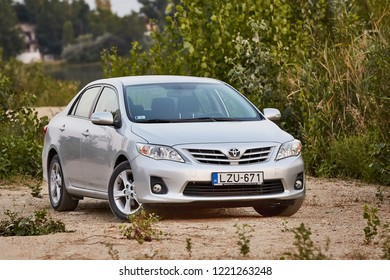 BAJNA, HUNGARY - OCTOBER 28, 2016: Toyota Corolla 2011 model E15 facelift in a field. Corollas are one of the best selling cars in the world