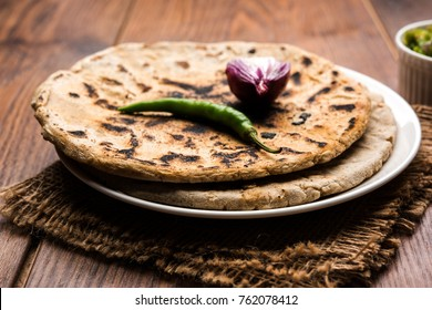 Bajra or Jowar Roti or Indian bread, served with green chilly thecha OR Chutney
