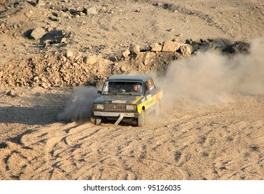 BAKAL, RUSSIA - AUGUST 13: Ruslan Muhamatnurov's Lada Zhiguli (No. 58) competes at the annual Rally Southern Ural on August 13, 2010 in Bakal, Satka district, Chelyabinsk region, Russia.