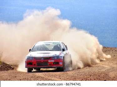 BAKAL, RUSSIA - AUGUST 3: Lagunov Dmitriy's Mitsubishi Lancer Evo IX (No. 11) competes at the annual Rally Southern Ural on August 3, 2007 in Bakal, Satka district, Chelyabinsk region, Russia.