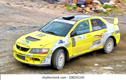 BAKAL, RUSSIA - JULY 21: Andrey Smirnov's Mitsubishi Lancer Evo IX (No. 11) competes at the annual Rally Southern Ural on July 21, 2012 in Bakal, Satka district, Chelyabinsk region, Russia.