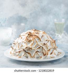 Baked Alaska, ice cream cake with meringues, selective focus