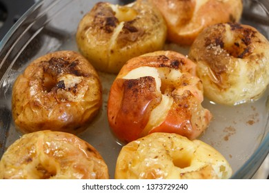 Baked apples with cinnamon in a glass dish