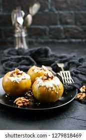 baked apples with nuts and honey, desert on plate