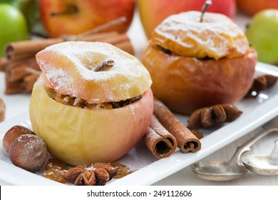 baked apples stuffed with dried fruit, nuts and cottage cheese on plate, close-up, horizontal