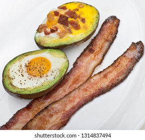 Baked avocado with eggs , cheese and bacon ,close up