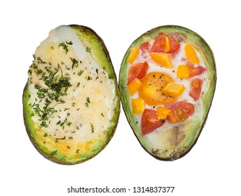 Baked avocado with eggs , cheese and vegetables isolated on white background