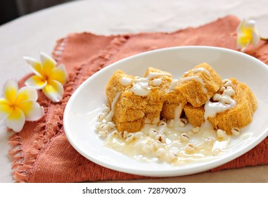 """Baked bean """"Khanom La"""" paste with yogurt sauce. And biscuits"""